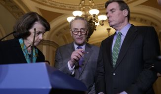 Senate Minority Leader Chuck Schumer of N.Y., center, joined by Sen. Dianne Feinstein, D-Calif., the ranking member of the Senate Judiciary Committee, left, and Sen. Mark Warner, D-Va., vice chair of the Intelligence Committee, right, calls for an investigation into President Donald Trump's administration over its relationship with Russia, including when Trump learned that his national security adviser, Michael Flynn, had discussed U.S. sanctions with a Russian diplomat, Wednesday, Feb. 15, 2016, during a news conference on Capitol Hill in Washington. (AP Photo/J. Scott Applewhite)