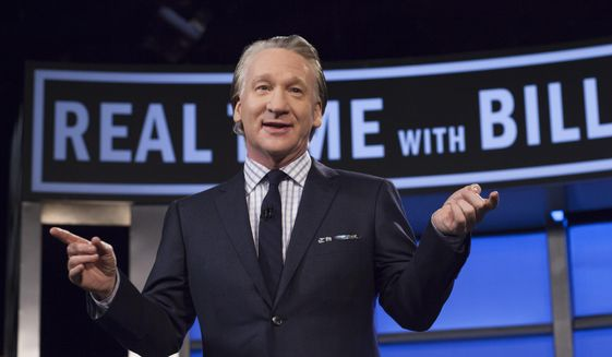 "This April 8, 2016 photo released by HBO shows Bill Maher, host of ""Real Time with Bill Maher,"" during a broadcast of the show in Los Angeles. (Janet Van Ham/HBO via AP)"