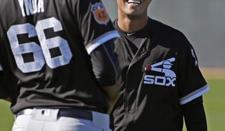Chicago White Sox pitchers Jose Quintana, right, and Michael Ynoa (66) share a laugh at the White Sox baseball spring training facility Wednesday, Feb. 15, 2017, in Glendale, Ariz. (AP Photo/Ross D. Franklin)