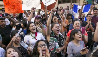 """Hundreds protest recent ICE raids in Austin, Texas, at the J.J. Pickle Federal Building in Austin during the """"Day Without Immigrants"""" on Thursday, Feb. 16, 2017.   Immigrants around the U.S. stayed home from work and school Thursday to demonstrate how important they are to Americas economy, and many businesses closed in solidarity, in a nationwide protest called A Day Without Immigrants.  (Jay Janner/Austin American-Statesman via AP)"""