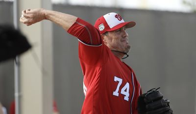 Washington Nationals pitcher Joe Nathan throws during a spring training baseball workout Thursday, Feb. 16, 2017, in West Palm Beach, Fla. (AP Photo/David J. Phillip)