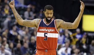 Washington Wizards forward Markieff Morris (5) celebrates in the final minute of the second half of an NBA basketball game against the Indiana Pacers in Indianapolis, Thursday, Feb. 16, 2017. (AP Photo/Michael Conroy)