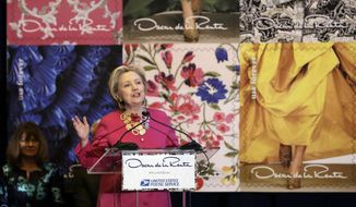 Hillary Clinton speaks during an unveiling postage stamps honoring the late fashion designer Oscar de la Renta in Grand Central Terminal, in New York, Thursday, Feb. 16, 2017. Clinton has praised Oscar de la Renta as an inspiration to striving immigrants like himself at an event honoring the late fashion designer with a series of commemorative stamps. (AP Photo/Richard Drew)