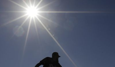 Los Angeles Dodgers' Sergio Romo throws during a spring training baseball workout Tuesday, Feb. 14, 2017, in Glendale, Ariz. (AP Photo/Morry Gash)
