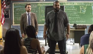 """This image released by Warner Bros. Pictures shows Ice Cube, right, and Charlie Day in a scene from """"Fist Fight."""" (Bob Mahoney/Warner Bros. Pictures via AP)"""