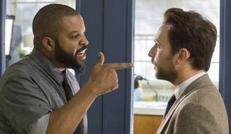 "This image released by Warner Bros. Pictures shows Ice Cube, left, and Charlie Day in a scene from ""Fist Fight."" (Bob Mahoney/Warner Bros. Pictures via AP)"