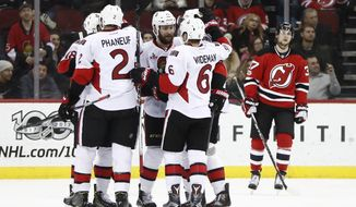 Ottawa Senators players celebrate a goal by defenseman Dion Phaneuf (2) during the second period of an NHL hockey game against the New Jersey Devils, Thursday, Feb. 16, 2017, in Newark, N.J. (AP Photo/Julio Cortez)