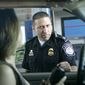U.S. Customs and Border Protection officer Kevin Corsaro speaks with an unidentified motorist entering the United States from Canada at the border in Buffalo, N.Y., Tuesday, June 6, 2006. U.S. authorities tightened their checks of traffic from Canada as debate over the long and hard-to-police border intensified following the weekend arrests of 17 Muslim Canadians in a suspected Ontario terror plot. (AP Photo/David Duprey)