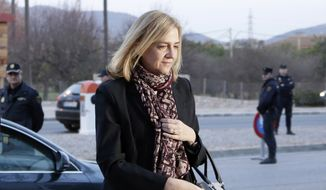 Spain's Princess Cristina arrives at court for a corruption trial, in Palma de Mallorca, Spain, in this Monday, Jan. 11, 2016, file photo. A Spanish court  on Friday Feb. 17, 2017, found Princess Cristina not guilty in a tax fraud case in which her husband, the brother-in-law of King Felipe VI, was sentenced Friday to 6 years and 3 months in prison for evading taxes, fraud and various other charges. (AP Photo/Emilio Morenatti, File)