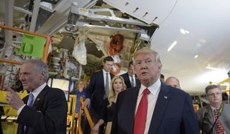 President Donald Trump tours the Boeing South Carolina facility in North Charleston, S.C., with South Carolina Gov. Henry McMaster, left, Friday, Feb. 17, 2017, to see the Boeing 787 Dreamliner. Trump is visiting Boeing before heading to his Mar-a-Lago estate in Palm Beach, Fla., for the weekend. (AP Photo/Susan Walsh)