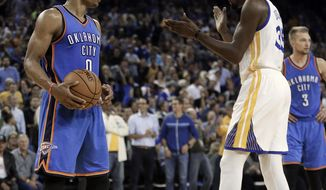 FILE - In this Nov. 3, 2016, file photo, Golden State Warriors' Kevin Durant, right, celebrates in front of Oklahoma City Thunder guard Russell Westbrook (0) during the first half of an NBA basketball game, in Oakland, Calif. The next time Russell Westbrook walks into a locker room for a game, Kevin Durant will be there. Get ready for the perhaps the best subplot of All-Star Weekend. The former Oklahoma City teammates and now rivals play as Western Conference teammates Sunday night, Feb. 19, 2017.(AP Photo/Ben Margot, File)