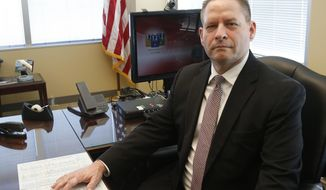 In this Feb. 9, 2017 photo, Rick Thornton, special agent in charge of the Minneapolis FBI office, poses in his office in Brooklyn Center, Minn. during an interview with the Associated press. Speaking on several topics including Islamic State recruitment, Thornton said over the last decade, roughly three dozen people have left Minnesota to join militant groups in Somalia or Syria, and nine Minnesota men were sentenced last year on federal charges of conspiring to join the Islamic State group. (AP Photo/Jim Mone)