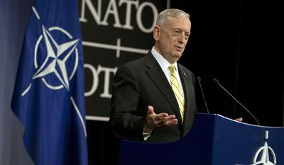"""U.S. Secretary of Defense Jim Mattis speaks during a media conference at NATO headquarters in Brussels on Thursday, Feb. 16, 2017. U.S. Defense Secretary Jim Mattis on has told NATO ministers that the alliance is """"a fundamental bedrock for the United States"""" while at the same time demanding an increased financial commitment from the 27 other alliance members. (AP Photo/Virginia Mayo)"""