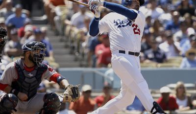FILE - In this Aug. 6, 2016, file photo, Los Angeles Dodgers' Adrian Gonzalez watches his RBI single in front of Boston Red Sox catcher Sandy Leon during a baseball game in Los Angeles. Gonzalez is taking a two-week break from hitting to heal tendinitis in hisright elbow. Gonzalez still hopes to play for Mexico in the World Baseball Classic next month, he said Friday, Feb. 17, after reporting to camp. (AP Photo/Alex Gallardo, File)