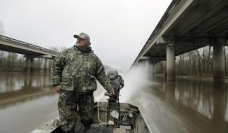 Commercial fisherman Jody Meche runs between the Interstate 10 bridges in the Atchafalaya Basin on his way to bait his crawfish traps on Friday, Feb. 3, 2017. Meche says he does not necessarily oppose the proposed Bayou Bridge Pipeline but worries it will aggravate water flow issues in the basin. (Brett Duke/NOLA.com The Times-Picayune via AP)