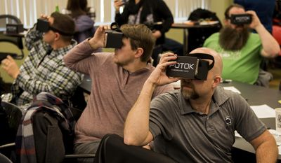 In this Friday, Feb. 10, 2017 photo, a class about virtual reality technology in the classroom is led for teachers from Allegheny and Westmoreland County at Allegheny Intermediate Unit in Homestead, Pa.  (Nate Smallwood /Pittsburgh Tribune-Review via AP)