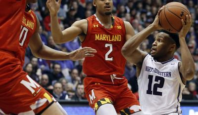 Northwestern guard Isiah Brown, right, looks to pass as Maryland forward Ivan Bender, left, forward LG Gill, center, and guard Melo Trimble (2) guard during the second half of an NCAA college basketball game Wednesday, Feb. 15, 2017, in Evanston, Ill. Maryland won 74-64. (AP Photo/Nam Y. Huh)
