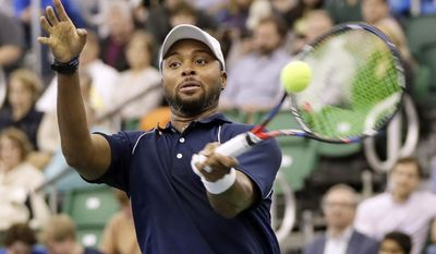 Donald Young, of the United States, returns a shot to John Isner, of the United States, in a quarterfinal at the Memphis Open tennis tournament Friday, Feb. 17, 2017, in Memphis, Tenn. (AP Photo/Mark Humphrey)