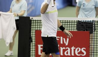 Mikhail Kukushkin, of Kazakhstan, waves to fans after defeating Steve Johnson, of the United States, 6-0, 6-4, in a quarterfinal at the Memphis Open tennis tournament Friday, Feb. 17, 2017, in Memphis, Tenn. (AP Photo/Mark Humphrey)