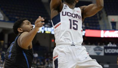 Connecticut's Rodney Purvis goes to the basket as Memphis' Dedric Lawson, left, defends in the second half of an NCAA college basketball game, Thursday, Feb. 16, 2017, in Hartford, Conn. (AP Photo/Jessica Hill)