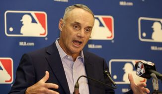 FILE - In this Feb. 3, 2017, file photo, Major League Baseball Commissioner Rob Manfred speaks during a news conference following a meeting with team owners in Palm Beach, Fla.   (AP Photo/Lynne Sladky, File) **FILE**