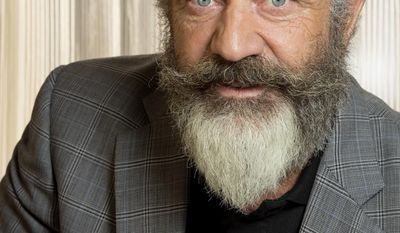 """FILE - This Oct. 26, 2016 file photo shows director Mel Gibson posing to promote his film, """"Hacksaw Ridge,"""" at the Ritz Carlton in New Orleans. Gibson is nominated for an Oscar for best directing for his work on the film.  (AP Photo/Max Becherer, File)"""