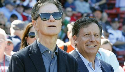 FILE - In this Sept. 27, 2015, file photo, Boston Red Sox owners John Henry, left, and Tom Werner are shown before a baseball game between the Red Sox and the Baltimore Orioles in Boston. John Henry called it strange not to see David Ortiz at the team's first full-squad workout this year and knows only one achievement will satisfy the team's management, players and fans. Werner said they've had discussions about what role the 41-year-old will have with the club. (AP Photo/Michael Dwyer, File)
