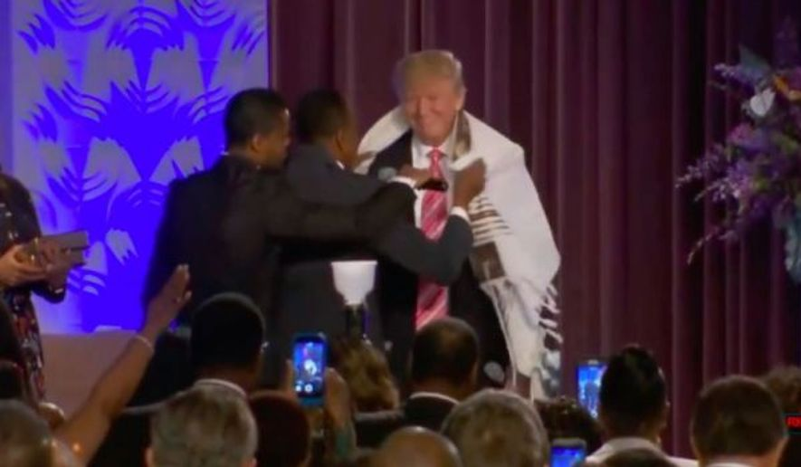 Then-presidential candidate Donald Trump at the Greater Faith Ministries International Church in Detroit. (Associated Press)