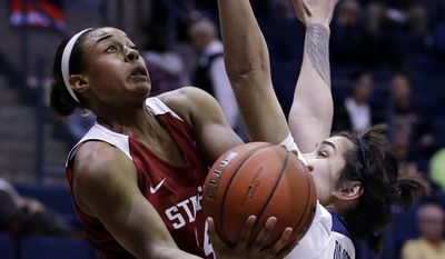 Stanford's Erica McCall, left, shoots against California's Penina Davidson during the first half of an NCAA college basketball game Thursday, Feb. 16, 2017, in Berkeley, Calif. (AP Photo/Ben Margot)