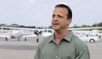 In this Thursday, Feb. 16, 2017 photo, Jonathan Miller, Chief Executive Officer of Stellar Aviation Group, talks to a reporter at Lantana Airport in Lantana, Fla. Miller says everyone agrees the president needs to be kept safe but hopes that some kind of compromise can be found to keep the facility open during Trump's visits. Otherwise, he fears that some of the airport's 28 businesses will go under. (AP Photo/Alan Diaz)