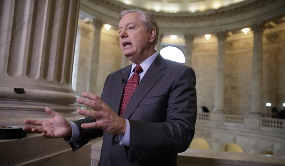 Sen. Lindsey Graham, R-S.C., a member of the Armed Services Committee and the Judiciary Committee, responds during a TV news interview to a question about President Donald Trump's administration and ousted national security adviser Michael Flynn, Wednesday, Feb. 15, 2017, on Capitol Hill in Washington. (AP Photo/J. Scott Applewhite) ** FILE **
