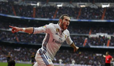 Real Madrid's Gareth Bale celebrates after scoring his side's second goal against Espanyol during a Spanish La Liga soccer match between Real Madrid and Espanyol at the Santiago Bernabeu stadium in Madrid, Saturday, Feb. 18, 2017. Bale scored one in Real Madrid's 2-0 victory. (AP Photo/Francisco Seco)