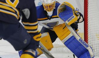 St. Louis Blues goalie Jake Allen (34) keeps his eyes on the puck during the first period of an NHL hockey game against the Buffalo Sabres, Saturday, Feb. 18, 2017, in Buffalo, N.Y. (AP Photo/Jeffrey T. Barnes)
