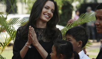 "Hollywood actress Angelina Jolie smiles before a press conference in Siem Reap province, Cambodia, Saturday, Feb. 18, 2017. Jolie on Saturday launches her two-day film screening of ""First They Killed My Father"" in Angkor complex in Siem Reap province. (AP Photo/Heng Sinith)"