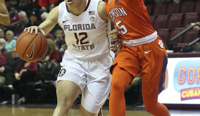 Florida State's Brittany Brown works the ball up court as Clemson's Danielle Edwards defends in the first quarter of an NCAA college basketball game, Saturday, Feb. 18, 2017, in Tallahassee, Fla. (AP Photo/Steve Cannon)