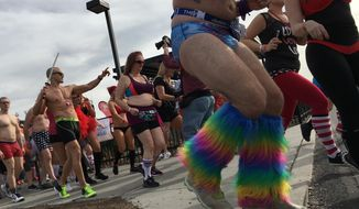 Joggers wearing in boxers, briefs, bras, bloomers and other underwear take off at the start of Cupid's Undie Run for charity in Philadelphia on Saturday, Feb. 18. 2017. (AP Photo/Dino Hazel)