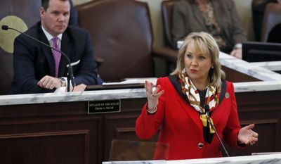 FILE - In this Feb. 6, 2017, file photo, Oklahoma Gov. Mary Fallin delivers her State of the State address in Oklahoma City as Lt. Gov. Todd Lamb listens at left. Fallin's ambitious proposal to expand the state sales tax to dozens of services to help close a giant hole and raise teacher pay appears on life support as her fellow Republicans quickly distance themselves from it. Lamb, a likely candidate for governor in 2018, resigned his position on Fallin's cabinet over the proposal, and other potential candidates for governor and rank-and-file GOP House members have panned the plan as a non-starter. (AP Photo/Sue Ogrocki, File)