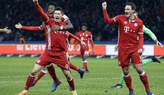 Bayern's Robert Lewandowski, front left, celebrates after scoring his side's first goal during the German Bundesliga soccer match between Hertha BSC Berlin and FC Bayern Munich in Berlin, Germany, Saturday, Feb. 18, 2017. (AP Photo/Michael Sohn)