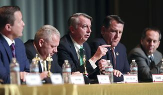 Ed Gillespie, center, speaks during the Millennial Advocacy Council PAC and NextGen GOP statewide candidate debate Saturday, Feb. 18, 2017, in Charlottesville, Va. (Ryan M. Kelly/The Daily Progress via AP)