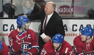 Montreal Canadiens head coach Claude Julien talks with players Max Pacioretty (67), Alex Galchenyuk (27) and Michael McCarron during the frist period of an NHL hockey game against the Winnipeg Jets in Montreal, Saturday, Feb. 18, 2017. (Graham Hughes/The Canadian Press via AP)
