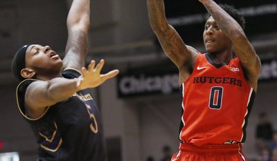 Rutgers guard Nigel Johnson, right, shoots over Northwestern center Derek Pardon during the first half of an NCAA college basketball game Saturday, Feb. 18, 2017, in Evanston, Ill. (AP Photo/Nam Y. Huh)