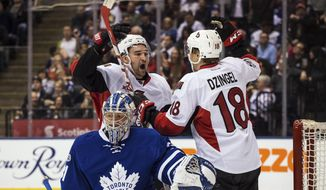Ottawa Senators right wing Mark Stone (61) celebrates with left wing Ryan Dzingel (18) after a goal by Chris Wideman (not shown) as Toronto Maple Leafs goalie Frederik Andersen (31) looks on during first period NHL hockey action in Toronto on Saturday, Feb. 18 2017. (Aaron Vincent Elkaim/The Canadian Press via AP)