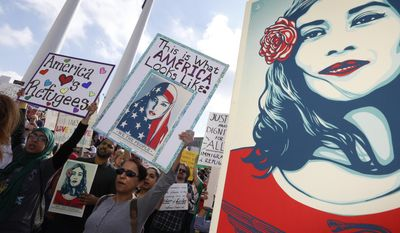 Protestors rallied in support of immigrants and refugees in downtown Dallas, Saturday, Feb. 18, 2017. Over 1,500 people rallied in a peaceful show of support for immigrants and refugees, protesting President Donald Trump's immigration policies. (Nathan Hunsinger/The Dallas Morning News via AP)