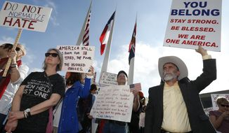 Protestors rallied in support of immigrants and refugees in downtown Dallas Saturday,  Feb. 18, 2017. Over 1,500 people rallied in downtown Dallas in a peaceful show of support for immigrants and refugees, protesting President Donald Trump's immigration policies. (Nathan Hunsinger/The Dallas Morning News via AP)