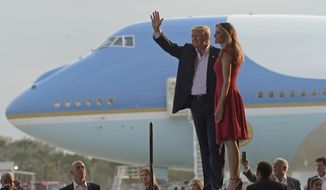 """President Donald Trump and first lady Melania Trump arrive for the """"Make America Great Again Rally"""" at Orlando-Melbourne International Airport in Melbourne, Fla., Saturday, Feb. 18, 2017. (AP Photo/Susan Walsh)"""