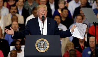 President Trump's campaign rally after a month in office filled an airport hangar Saturday in Florida. (Associated Press)