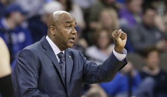 Georgetown coach John Thompson III signals a play during the first half of an NCAA college basketball game against Creighton in Omaha, Neb., Sunday, Feb. 19, 2017. (AP Photo/Nati Harnik) **FILE**