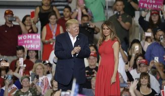 President Donald Trump with his wife, First Lady Melania Trump during a campaign rally Saturday, Feb. 18, 2017, in Melbourne, Fla. (AP Photo/Chris O'Meara)