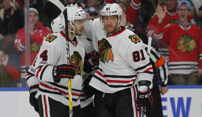 Chicago Blackhawks Niklas Hjalmarsson (4) and Marian Hossa (81) celebrate a goal during the second period of an NHL hockey game against the Buffalo Sabres, Sunday, Feb. 19, 2017, in Buffalo, N.Y. (AP Photo/Jeffrey T. Barnes)