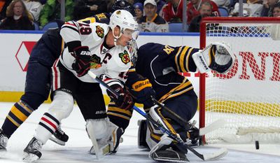 Chicago Blackhawks forward Jonathan Toews (19) puts the puck past Buffalo Sabres goalie Robin Lehner (40) during the second period of an NHL hockey game, Sunday, Feb. 19, 2017, in Buffalo, N.Y. (AP Photo/Jeffrey T. Barnes)